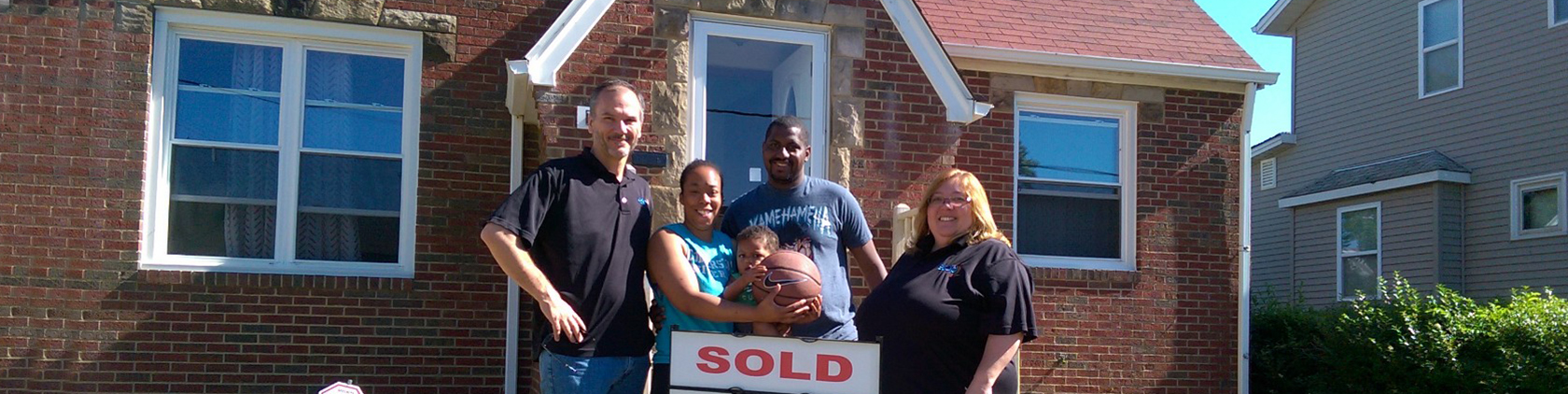 Photo of new home owners with ESOP staff